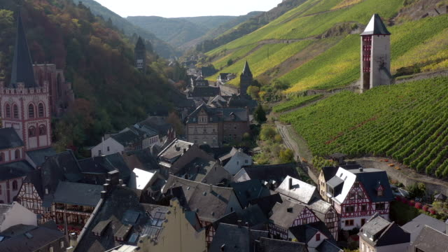 The Picturesque Town of Bacharach on the Shores of the Rhine in Germany Aerial view of the German town of Bacharach on the shores of the River Rhine an 11th century settlement in Western Germany. A popular tourist destination for local architecture and fine local wines produced from the vineyards in a valley. european culture stock videos & royalty-free footage