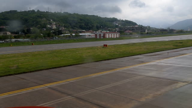 The plane taxis on the track. From the window The plane taxis on the track. From the window. airfield stock videos & royalty-free footage