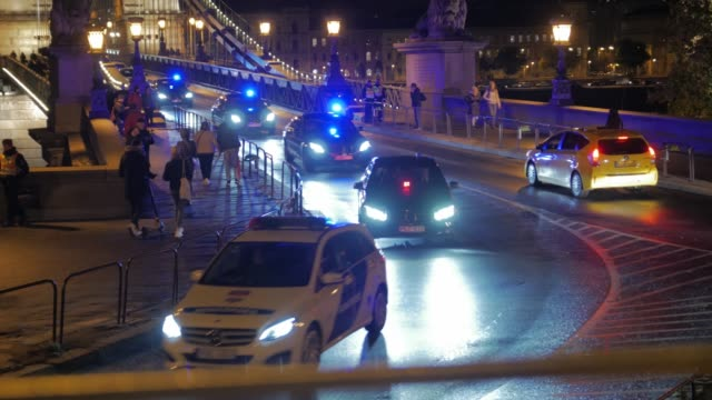 The Police Escort The police escort motorcade government a lot of cars ride at night over the Szechenyi Chain Bridge Budapest Hungary closeup president stock videos & royalty-free footage