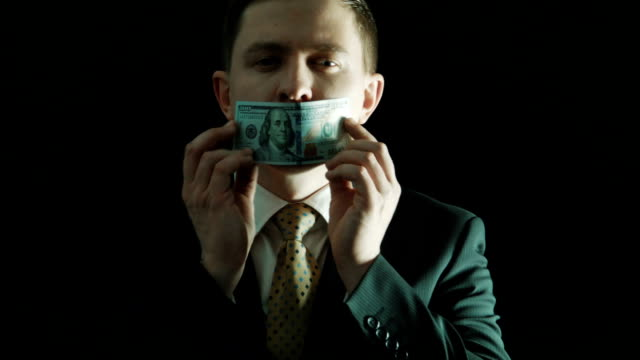 The politics in a suit closes mouth with the hundred-dollar note video