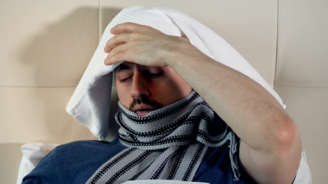 The portrait of the ill man suffering from the headache. 4K. The portrait of the ill man suffering from the headache. double bed stock videos & royalty-free footage