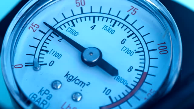 The pressure gauge needle moves around the dial and measurement the pressure