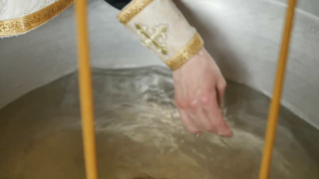 The priest crosses the water in font video