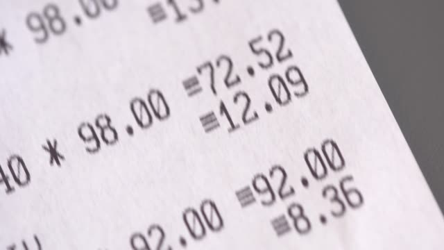 the printed receipt from supermarket close up - scontrino video stock e b–roll