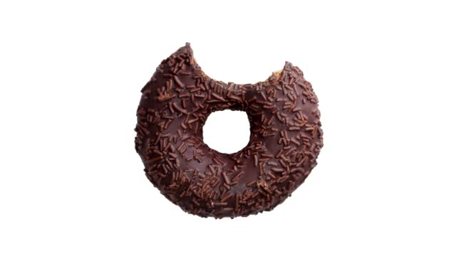 the process of eating a chocolate donut isolated on white background. top view - bombolone video stock e b–roll