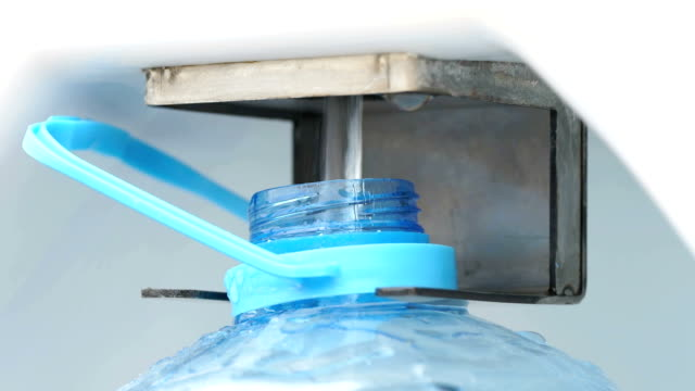 The process of filling drinking water. Close-up video