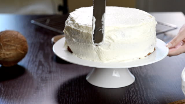 The process of making a cake.Confectioners equates biscuit cream using pastry spatula video