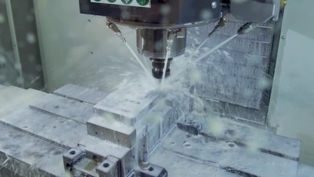 The process of milling a metal part on a CNC machine The process of milling a metal part on a CNC machine. The workpiece is machined when a lubricating-cooling liquid is supplied. metal worker stock videos & royalty-free footage