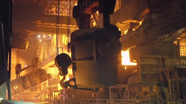The process of pouring iron into the converter. Steel production at a metallurgical plant.