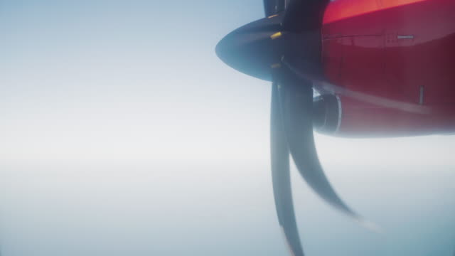 The propeller of an airplane during air travel