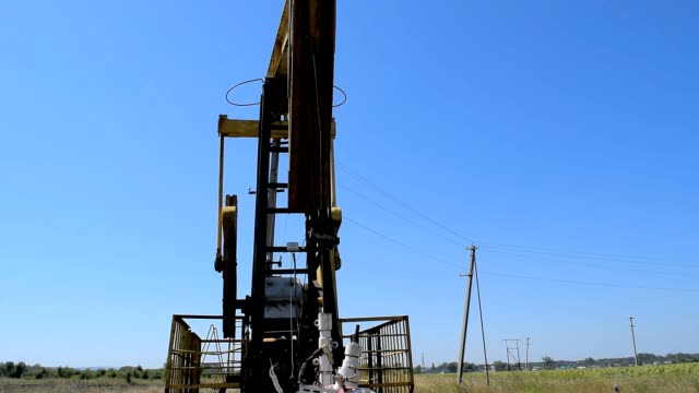 The pumping unit on a well. Equipment of oil wells video