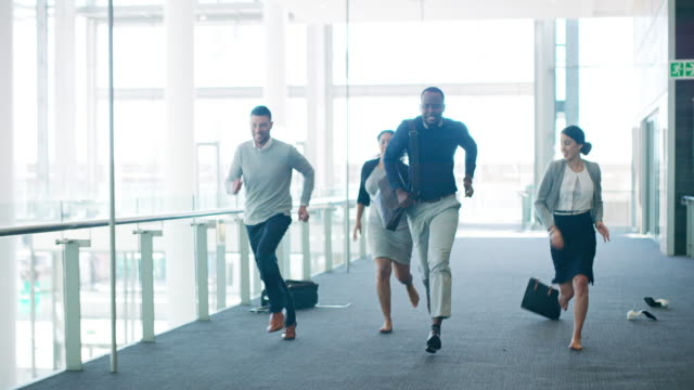 The race is on 4k video footage of a group of businesspeople racing through their office building contest stock videos & royalty-free footage