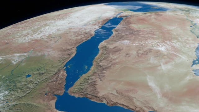 the red sea, with saudi arabia, jordan, israel, sinai peninsula, egypt, sudan, eritrea, djibouti and somalia, aerial view in planet earth from outer space - paesi del golfo video stock e b–roll