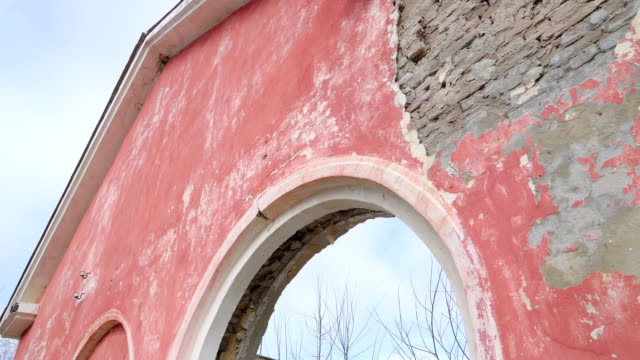 The red wall of the damaged house from the war video