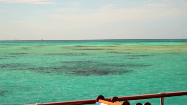 the reefs in the turquoise waters of the red sea. the view from the deck of a yacht - sky diving video stock e b–roll