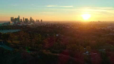 The remote aerial view of Downtown Los Angeles from the Elysian Park at sunset The remote aerial view of Downtown Los Angeles from the Elysian Park at sunset. 4K UHD drone video footage with the forward camera motion. horizon stock videos & royalty-free footage