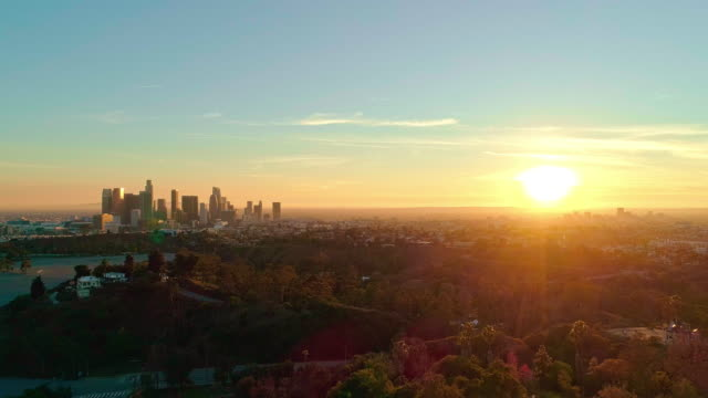 The remote aerial view of Downtown Los Angeles from the Elysian Park at sunset