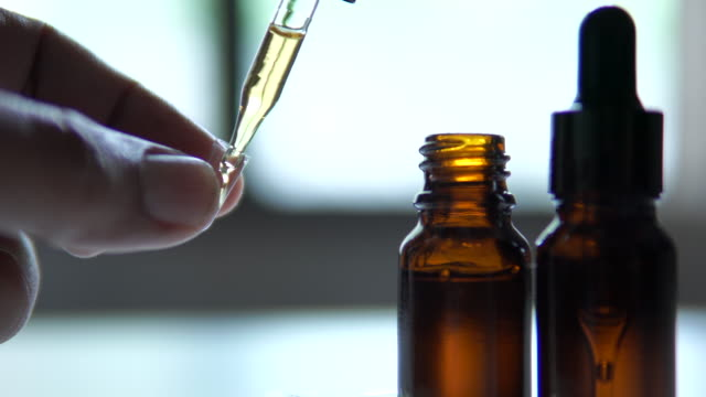 The researchers packed hemp oil in capsules to treat cancer patients The researchers packed hemp oil in capsules to treat cancer patients marijuana herbal cannabis stock videos & royalty-free footage