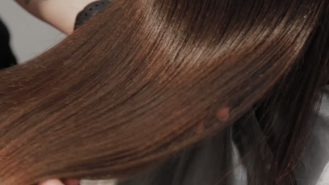the result of hair straightening at the hairdresser - włosy filmów i materiałów b-roll
