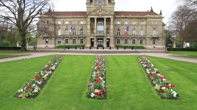 The Rhine Palace in Strasbourg. It is a former imperial palace which has become a historic and administrative monument. The lawns are planted with flowers. french architecture stock videos & royalty-free footage