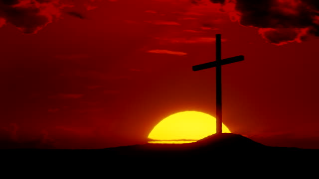 The Risen Christ: Time-lapse sunrise behind Calvary cross video
