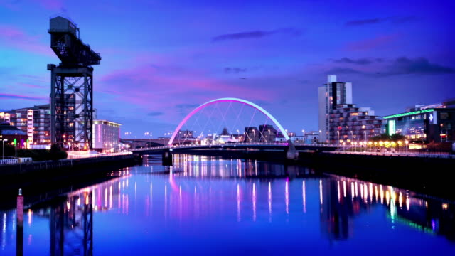 The River Clyde Arc Bridge at Dusk, Glasgow, Scotland Timelapse of the River Clyde Arc Bridge at dusk, Glasgow, Scotland scotland stock videos & royalty-free footage