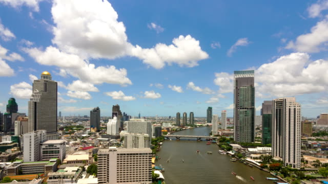 The river in Bangkok File 4K time lapse of building and building bridges over the river in Bangkok, Thailand suspension bridge stock videos & royalty-free footage