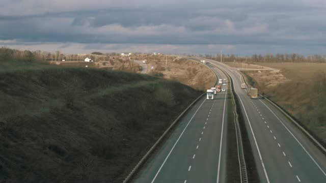 the Road goes into the distance. Highway in perspective and cars video