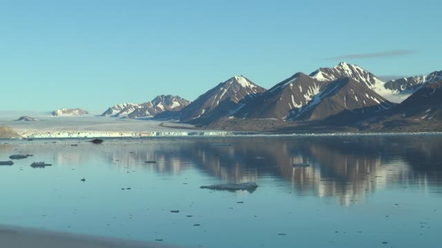 The rocky shores of  Svalbard archipelago, taken from a cruise ship .
