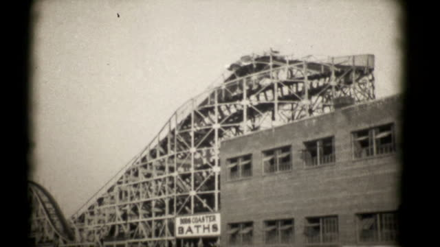 the roller coasters, coney island 1927. 16mm (hd1080) - roller coaster stock videos & royalty-free footage