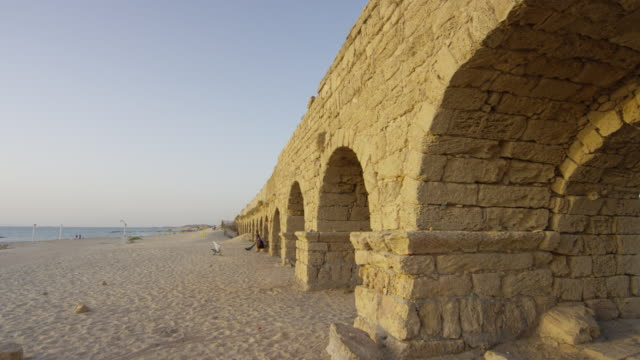 The Roman aqueduct and the beach The Roman aqueduct and the beach at Caesarea Maritima. aqueduct stock videos & royalty-free footage