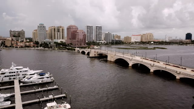 The Royal Park Bridge Connects Palm Beach to West Palm Beach A storm passes over Palm Beach Florida on the Atlantic Ocean and the East Coast florida us state stock videos & royalty-free footage