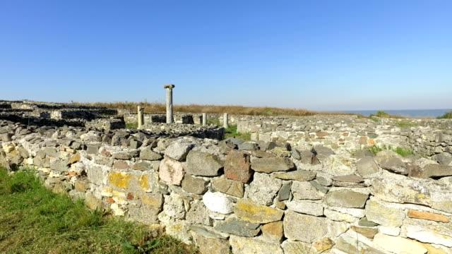 the ruins of medieval fortress histria in dobrogea romania - męczennik filmów i materiałów b-roll