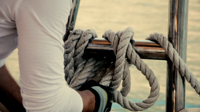 The sailor turns the rope on the yacht video