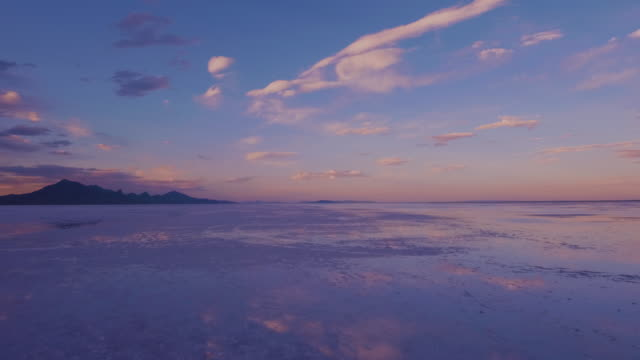 The Salt Flats landscape at Dusk The beautiful natural terrain of the salt flats in Utah as seen at sunset on a summer day. salt flat stock videos & royalty-free footage