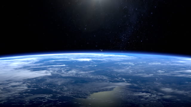 The satellite is orbiting the Earth. The satellite is flying from far away quickly, and disappears from the camera. The earth rotates slowly. 4K. video