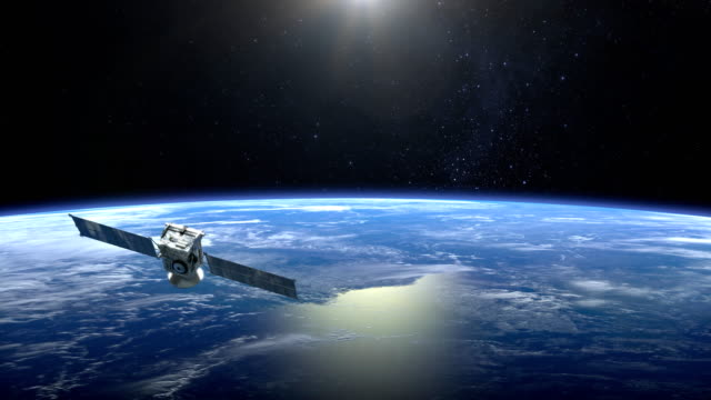 the satellite scan and monitor the earth. the satellite slowly flies away. the earth rotates slowly. 4k. - искусственный спутник земли стоковые видео и кадры b-roll
