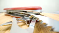 istock The saw blade and the scissor parts of the swiss knife 1257634350