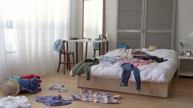 the scene of a messy girl bedroom. - bedroom video stock e b–roll