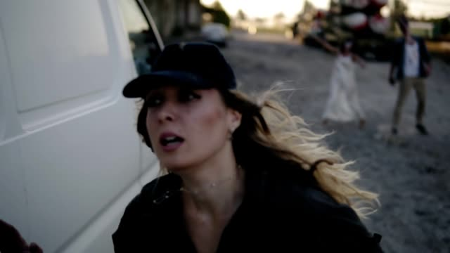 The scene of the scared girl runs away from the zombie, hiding behind the white van then run away. Two creepy zombies coming for her. Filming, halloween, horror concept The scene of the scared girl runs away from the zombie, hiding behind the white van then run away. Two creepy zombies coming for her. Filming, halloween, horror concept. chasing stock videos & royalty-free footage