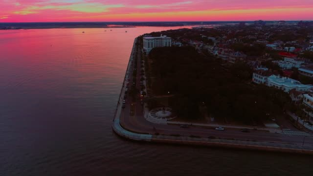 The scenic aerial panoramic view of Charleston, South Carolina, at sunset The scenic aerial panoramic view of Charleston, South Carolina, at sunset. 4K UHD accelerated drone video footage with the panoramic camera motion. south carolina stock videos & royalty-free footage