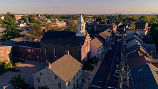 The scenic view of the small Pennsylvanian town Bath at sunset. Appalachian mountains, Pennsylvania, USA. Aerial drone video with the panoramic camera motion. The scenic view of the small Pennsylvanian town Bath at sunset.  4K UHD aerial drone video footage. americana stock videos & royalty-free footage