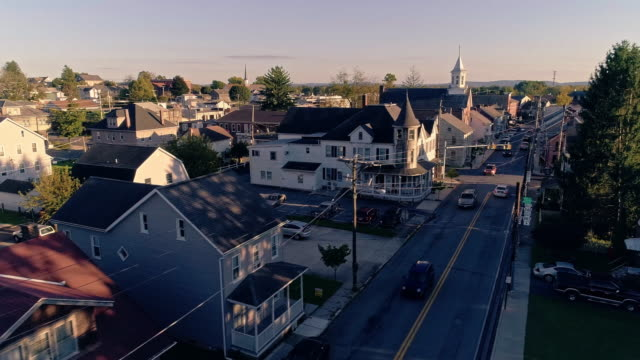 The scenic view of the small Pennsylvanian town Bath at sunset. Appalachian mountains, Pennsylvania, USA. Aerial drone video with the panoramic camera motion. The scenic view of the small Pennsylvanian town Bath at sunset.  4K UHD aerial drone video footage. cable tv stock videos & royalty-free footage