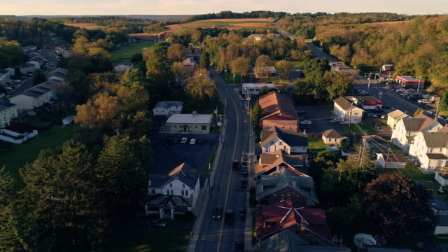 The scenic view of the small Pennsylvanian town Bath at sunset. Appalachian mountains, Pennsylvania, USA. Aerial drone video with the forward and descending camera motion.