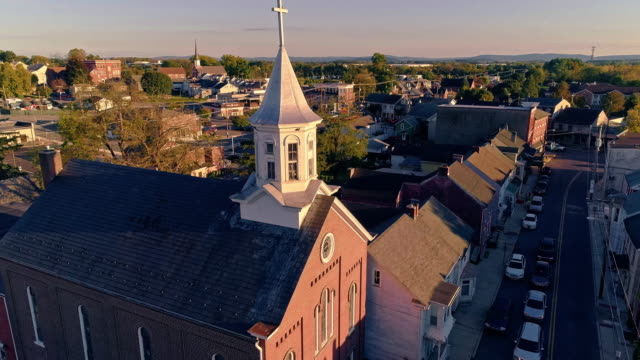 The scenic view of the small Pennsylvanian town Bath at sunset. Appalachian mountains, Pennsylvania, USA. Aerial drone video with the forward camera motion.
