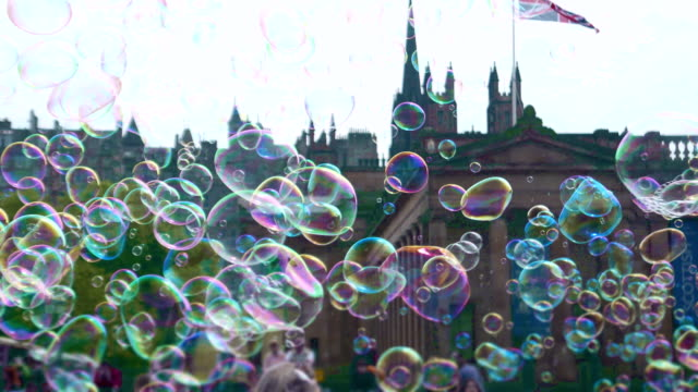 The Scottish old town filled with cheerful soap bubbles The Scottish old town filled with cheerful soap bubbles scotland stock videos & royalty-free footage