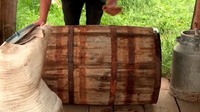 the secrets of pickling cucumbers in large barrels of salt spice recipe collection storage in cold brook, russia village - aglio cipolla isolated video stock e b–roll