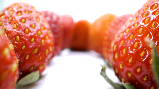 The seeds on the skin of the red strawberry