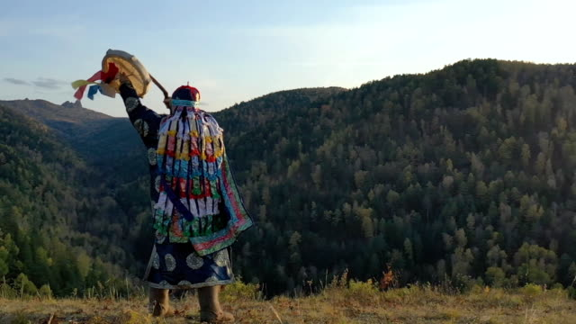 The shaman communicates with the spirits of the forest with dance with a tambourine.
