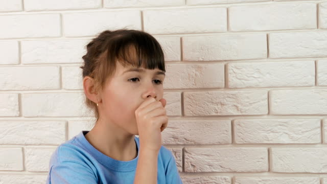 The sick child coughs. video